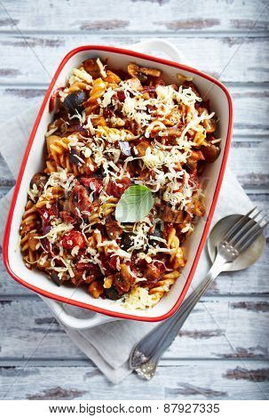 Fusilli pasta baked with cherry tomatoes, aubergine and cheese