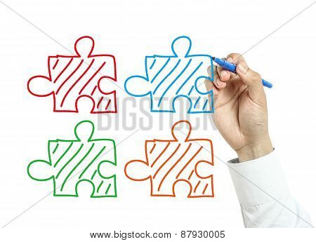 Businessman Drawing Puzzles