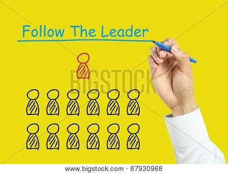 Businessman Hand Drawing Follow The Leader Concept