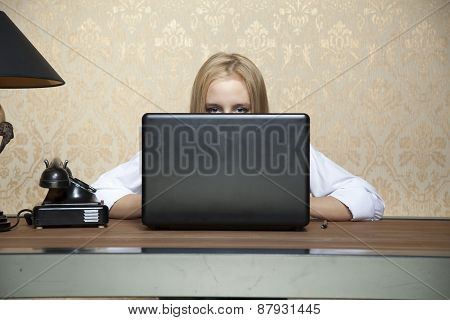 Business Woman Hiding Behind A Laptop