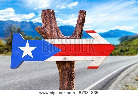 Puerto Rico Flag wooden sign with road background