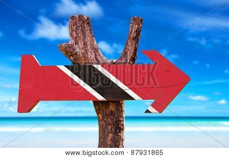Trinidad and Tobago Flag wooden sign with beach background