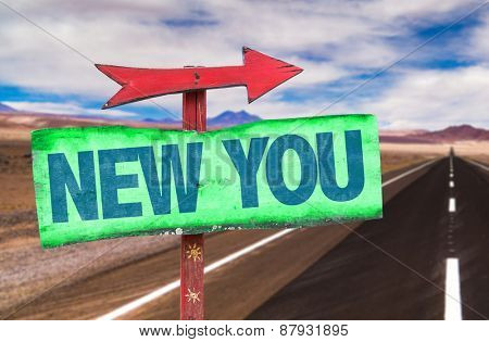 New You sign with road background