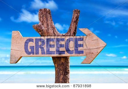 Greece wooden sign with beach background