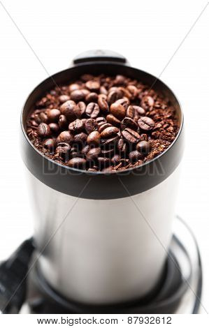 Coffee Grinder With Coffee Beans Isolated Macro