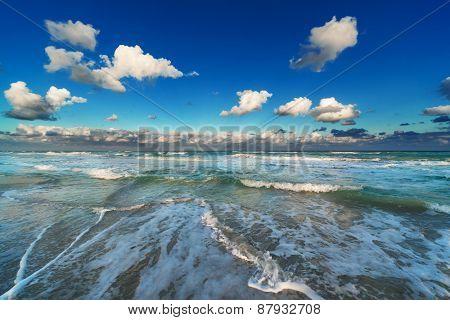 waves on the beach on a sunny day