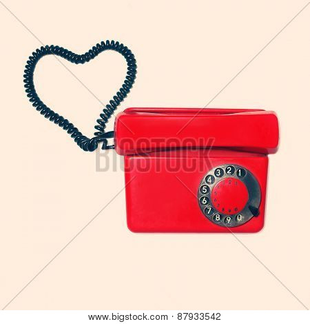 Red Old Retro Rotary Phone With Heart Shape Of Wire, Vintage Colors Photo