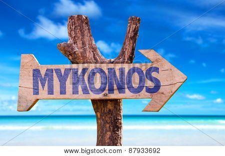 Mykonos wooden sign with beach background