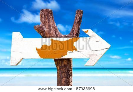Cyprus Flag wooden sign with beach background