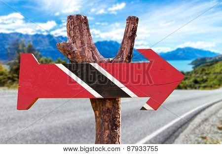 Trinidad and Tobago Flag wooden sign with road background