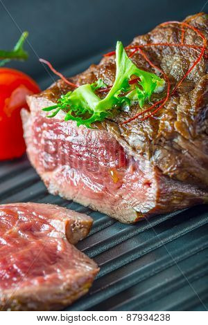 Grilled Beef steak with vegetable decoration. Grilled porterhouse steak