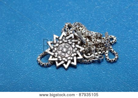 Silver Pendant In The Shape Of A Star
