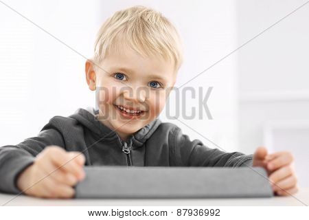 Preschooler playing games on a digital tablet