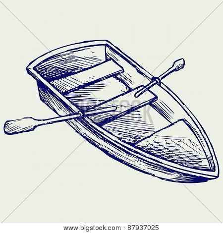 Wooden boat with paddles