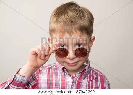 Boy In Plaid Shirt And Sunglasses Smiling