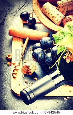 Bottle Of Red Wine With Fresh Grape And Corks