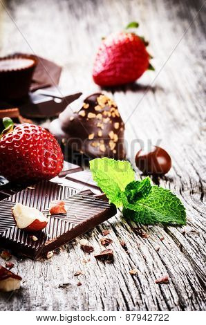 Assortment Of Fine Chocolates And Pralines With Fresh Strawberry