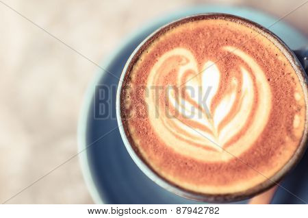 Latte Art, Blue Coffee Cup On Gray Background And Vintage Colour Effect.