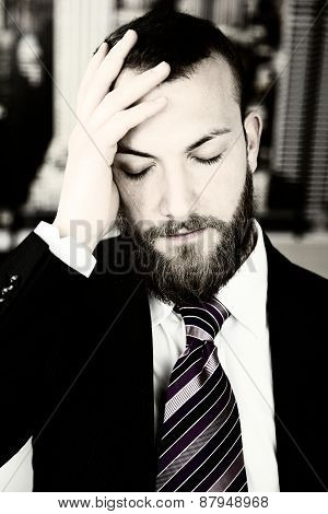 Business Man With Strong Headache Suffering