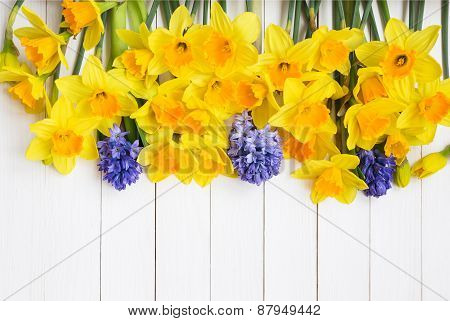Narcissus Flowers Over White Wooden Background