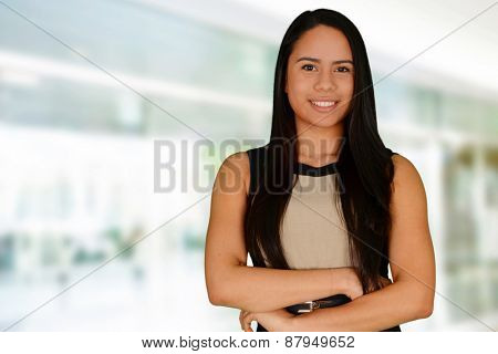 Young successful woman smiling at the camera