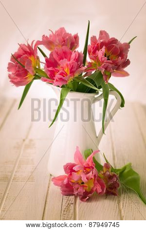 Beautiful pink double peony tulip in jug. vintage style