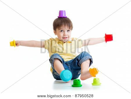 Smiling Child Boy Having Fun With Color Toys