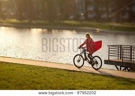 Girl Drives On Bike