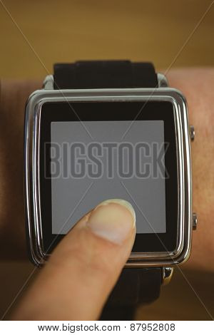 Businesswoman with smart watch on wrist shot in studio