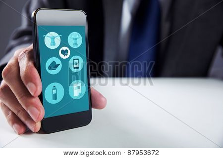 Businessman using smartphone against fitness apps