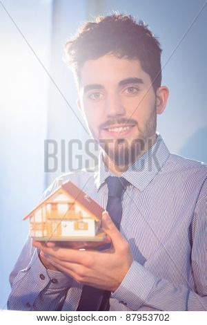 Businessman showing a key shot in studio
