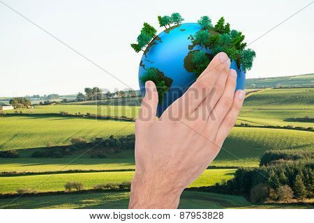 Businessman holding hand out in presentation against scenic landscape