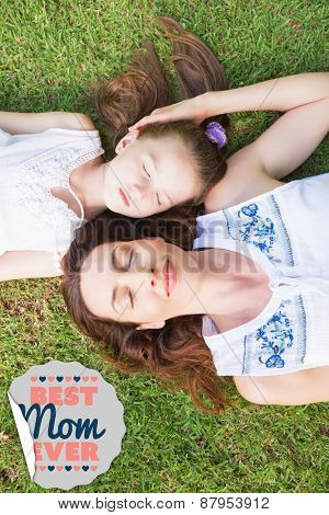 best mom ever against mother and daughter lying on grass
