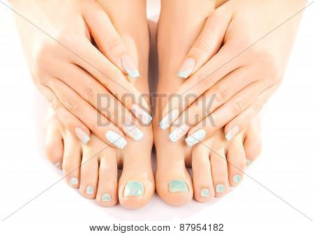 beautiful feet with turquoise pedicure isolated