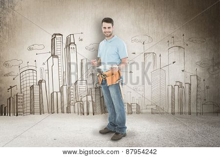 Smiling construction worker holding clipbard against hand drawn city plan