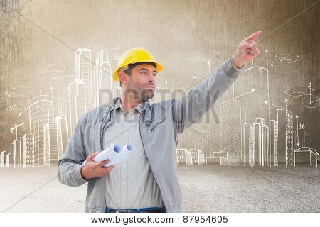 Architect pointing against hand drawn city plan