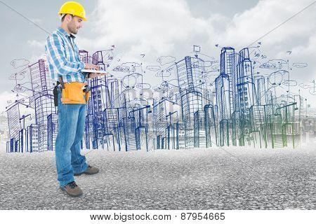 Full length of repairman using laptop against black road
