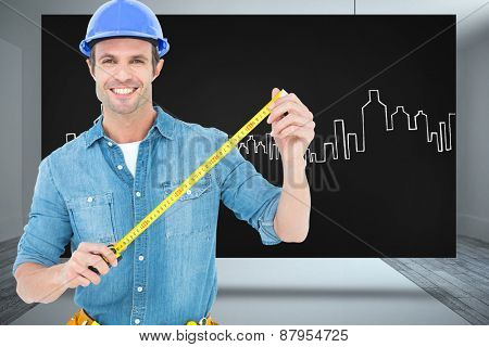 Male architect holding tape measure against composite image of black card