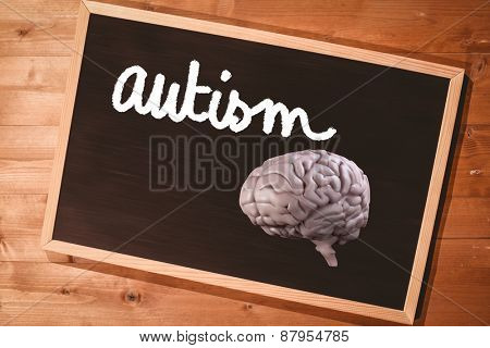brain against small blackboard on wooden floor