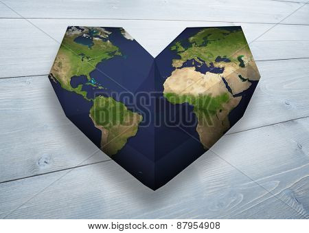 Heart shaped earth against bleached wooden planks background