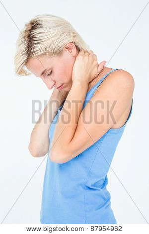 Woman suffering from neck pain on white background