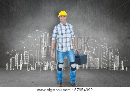 Male technician carrying tool box against hand drawn city plan