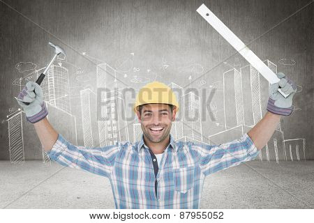 Smiling handyman holding hammer and level against hand drawn city plan