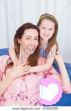 mothers day greeting against mother and daughter smiling at camera