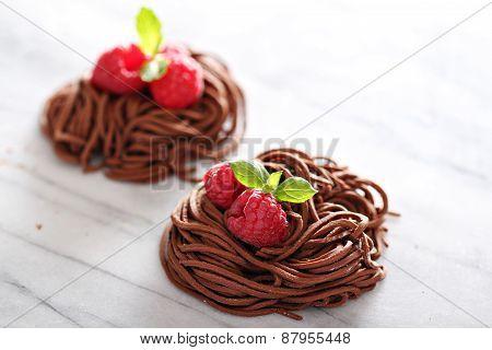Raw chocolate pasta nests with raspberry