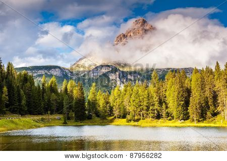 Great view of the foggy Lago Di Antorno with National Park Tre Cime di Lavaredo, Dolomites Range, South Tyrol. Location Auronzo di Cadore, Misurina, Italy, Europe. Dramatic overcast sky. Beauty world.