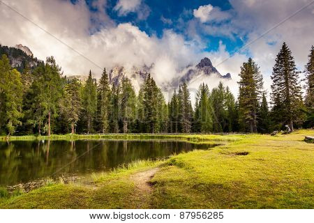 Great view of the foggy Lago Di Antorno in National Park Tre Cime di Lavaredo. Cadini di Misurina Range, Dolomites, South Tyrol. Location Auronzo, Italy, Europe. Dramatic overcast sky. Beauty world.