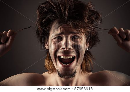 man shocked by the action of electricity