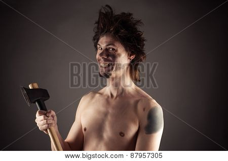 smiling man with an ax in hand