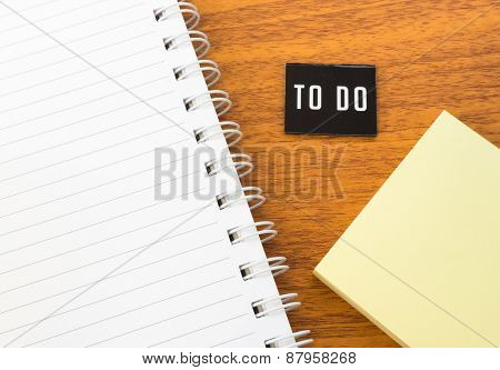 Open Book With To Do List And Postit On Table